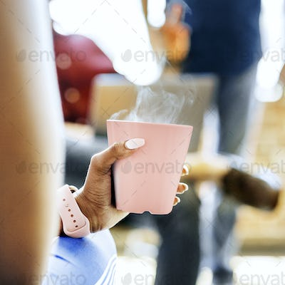 Black woman with a pink coffee cup
