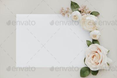 Blank invitation with rose decoration