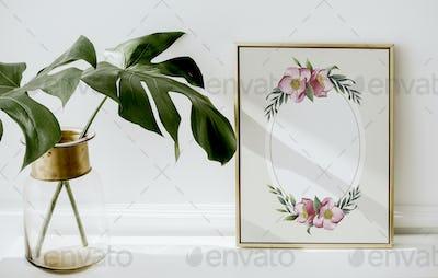 Floral golden frame by monstera leaves