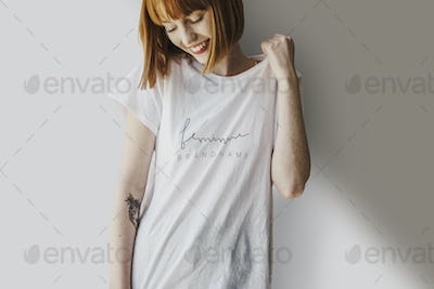 Happy young woman in a white t-shirt