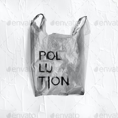 Pollution word written on a gray plastic bag mockup