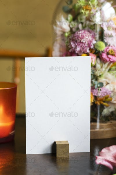 Card by bouquet of flowers on a wooden table