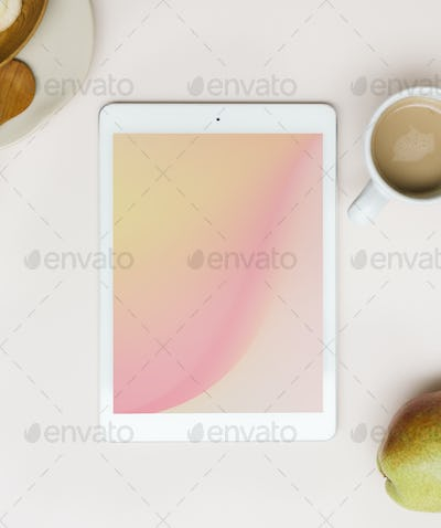 Tablet mockup on a pink table flatlay