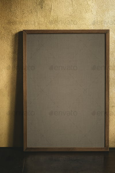 Blank wooden frame mockup by a grunge yellow wall