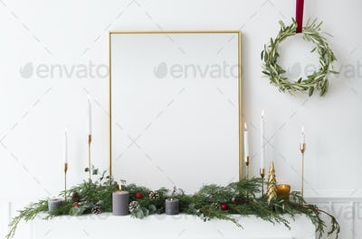 Festive golden photo frame against a white wall
