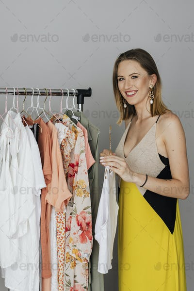 Stylist picking a dress