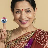 Indian woman showing a vote sticker
