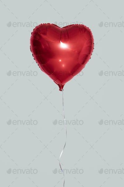 Heart shaped balloon mockup on a gray background