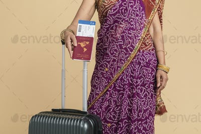 Indian woman in a saree ready for boarding