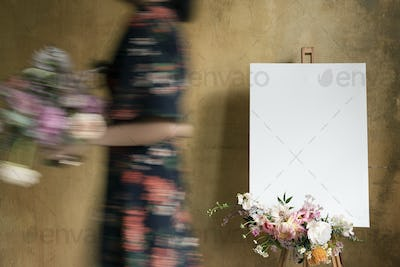 White canvas mockup with a bouquet of flowers