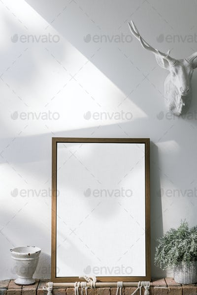 Wooden frame mockup against a white wall