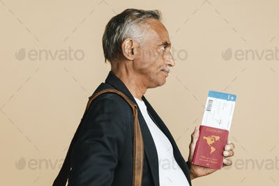 Senior mixed Indian man boarding the plane