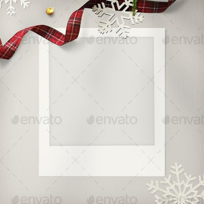 Blank photo frame mockup with Christmas decorations on cream background