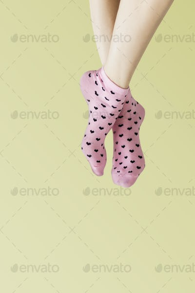 Woman in pink socks with her legs crossed