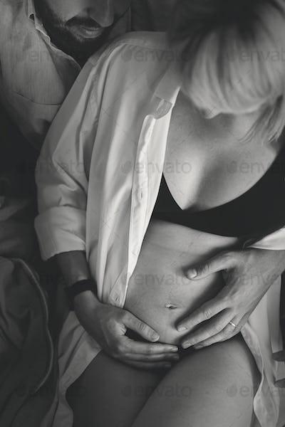 Seminude pregnancy photoshoot