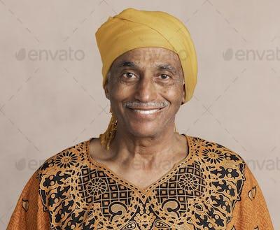 Happy mixed Indian senior man wearing a yellow turban mockup