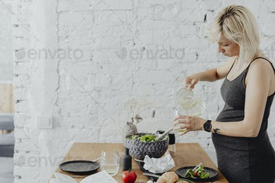 Pregnant woman making breakfast