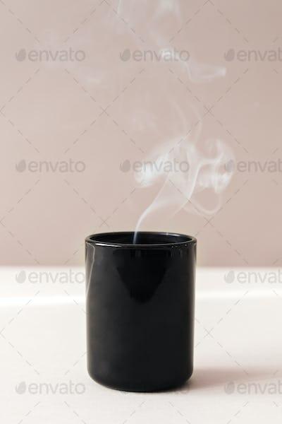 Steaming black coffee cup