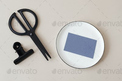 Blank personal card and black scissors mockup