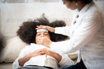 African American people, Mother is taking care of a sick daughter