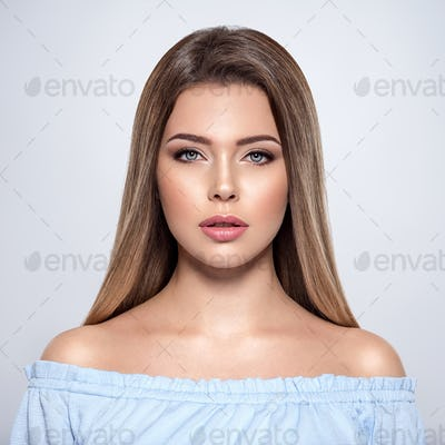 Closeup face of a beautiful woman with long straight hair.