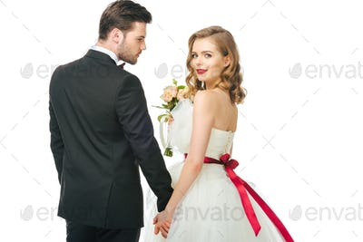 back view of wedding couple holding hands isolated on white