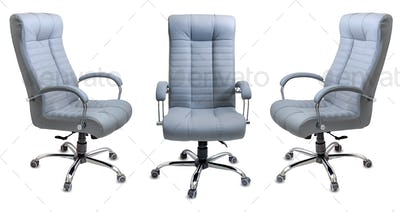 Set of large empty office chairs from gray leather, isolated on white background.