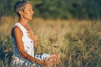 Positive Energy Meditation – Mindful Woman Meditating Outdoors, Absorbing the Positive Energy