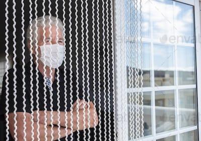 Coronavirus pandemic, senior man in self quarantine to avoid spread of infection by virus covid-19