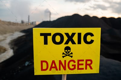 Notice announcing toxic and dangerous area with hills, polluted air and river and industrial fumes