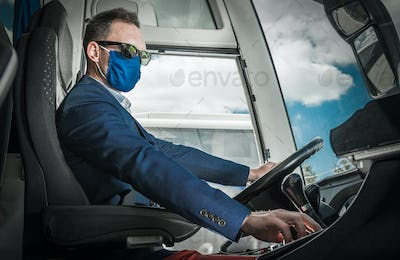 Bus Coach Driver in a Mask Preparing For the Road
