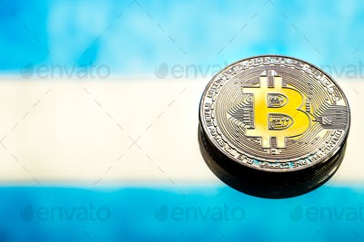 Coins Bitcoin, against the background of Argentina flag.