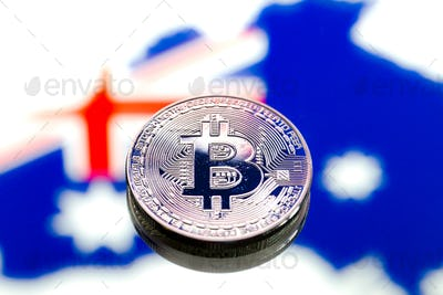 Coins Bitcoin, against the background of Australia and the Australian flag.