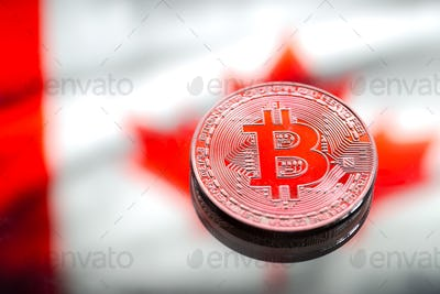 Coins Bitcoin, against the background of Canada flag.