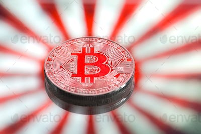 Coins Bitcoin, on a background of Japan and the Japanese flag.