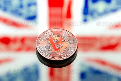 Coins Bitcoin, on a background of Great Britain and the British flag.
