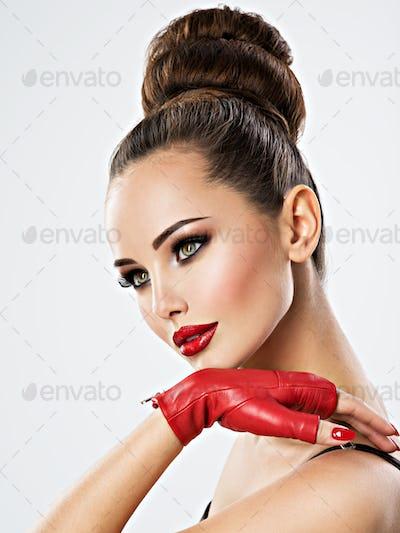Beautiful sensual woman with glamour makeup.