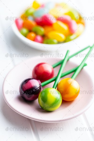 Sweet fruity lollipops and jelly beans.