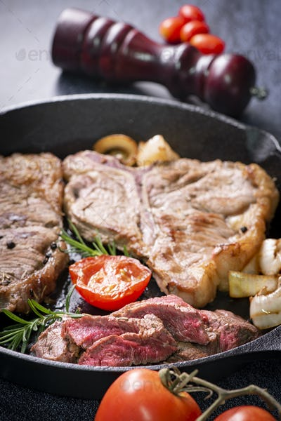 Grilled ribeye beef steak, herbs and spices. Top view