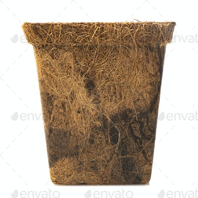 Coir plant pots isolated on white. Environmentally friendly spring gardening. Peat substitute
