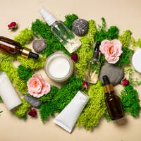 Natural cosmetic products with plants flowers and moss.