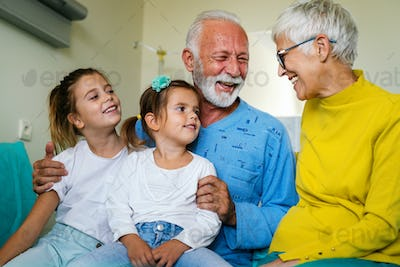 Family visiting mature male patient in hospital. Healthcare, pensioner, family support concept