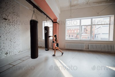 Female MMA fighter training punches technique