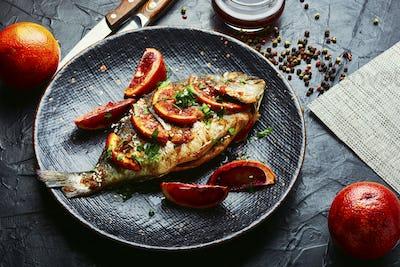 Grilled dorado fish on plate