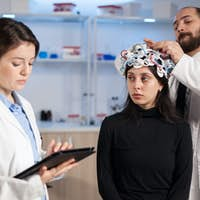 Neurological doctors developing brain treatment on young patient