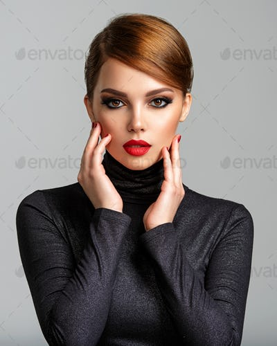 Beautiful girl with red lips and short hair. Pretty face of an young sensual woman.