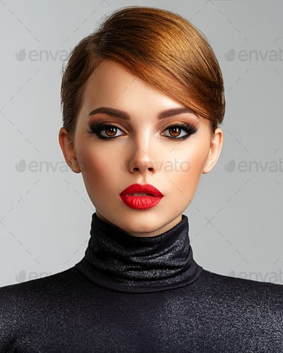 Beautiful girl with red lips and short hair.