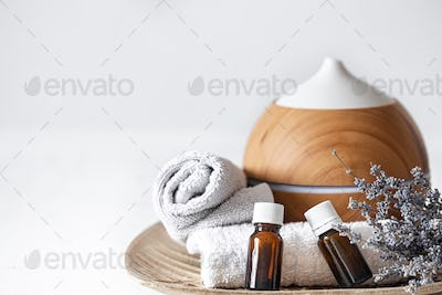 Spa composition with aroma diffuser and aromatic oils copy space.