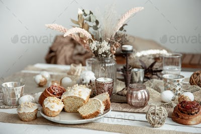 A beautifully set table for Easter with decorative details and pastries.