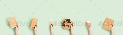 Banner with female hands holding zero waste recyclable office supplies. Eco friendly sustainable
